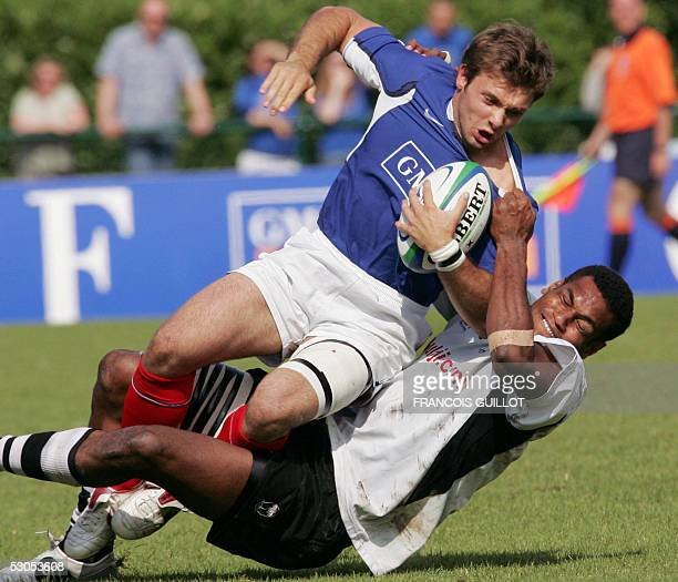 France's Vincent Clerc is tackled by Fiji's Sireli Naqelevuki during the Paris leg of the IRB World Series rugby sevens final match France vs Fiji 11...