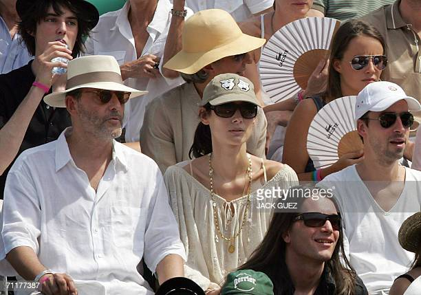 French actor Jean Reno is seen in the stands during the match opposing Spain's Rafael Nadal to Swiss Roger Federer during the French tennis Open...