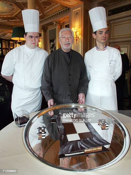 French fashion designer Paco Rabanne with chefs Guillaume Caron and Laurent Delarbre displays his first pastry creation a chocolate draughtboard in...