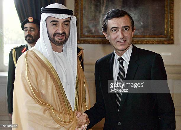 French Foreign Minister Philippe DousteBlazy poses with crown prince of Abu Dhabi sheikh Mohammed bin Zayed Al Nahyan before their meeting 20 June...