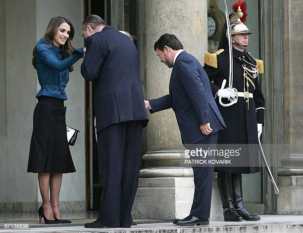 French President Jacques Chirac kisses the hand of Queen Rania while they leave with Jordan's King Abdullah II 20 March 2006 the Elysee Palace in...