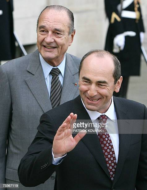 French President Jacques Chirac walks back his Armenian counterpart Robert Kocharian after a working lunch 19 February 2007 at the Elysee Palace in...