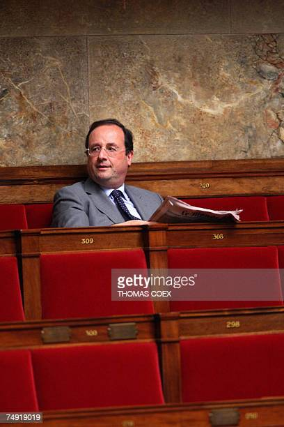 French Socialist Party first secretarty and deputy Francois Hollande attend the opening session of the French National Assembly 26 June 2007 in Paris...