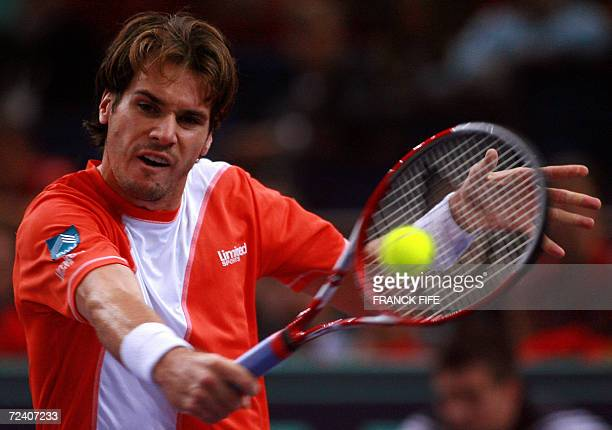 Germany's Tommy Haas returns to Slovakia's Dominik Hrbaty during their Paris Tennis Masters Series semifinal match at Bercy indoor tournament 04...