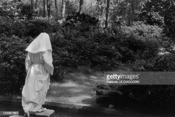 Paris France in 1990 A young girl who is dressed for her first communion in the Bois de Vincennes