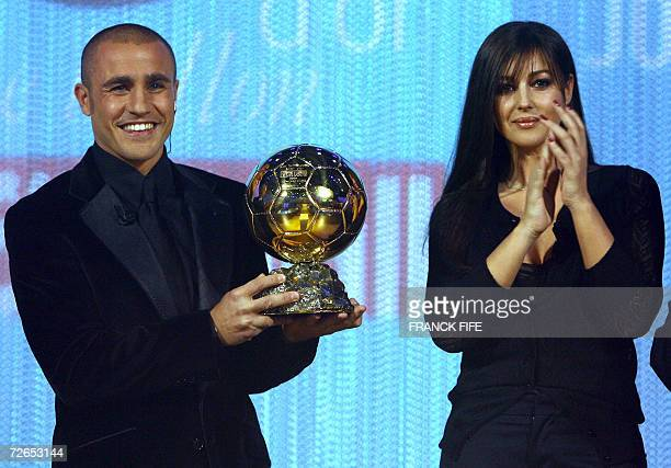 Italy's World Cupwinning captain Fabio Cannavaro is congratuled by actress Monica Belluci after being awarded the 2006 'Ballon d'Or' for best...