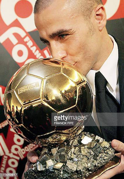 Italy's World Cupwinning captain Fabio Cannavaro kisses his trophy after being awarded the 2006 'Ballon d'Or' for best football player of the year 27...