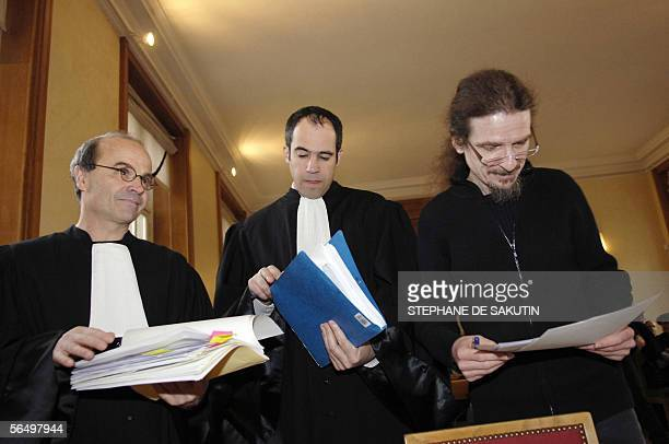 Michel Parigot Andeva's vicepresident Michel Ledoux Andeva's lawyer and Francois Lafforgue Greenpeace's lawyer check papers at the Paris...