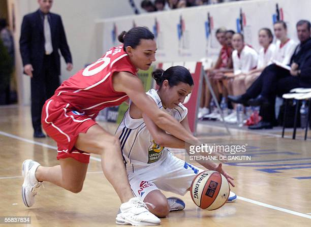Montpellier's captain Flore Perotto fights for the ball with Mondeville's Amelie Pochet 02 October 2005 at the Pierre de Coubertin stadium in Paris...