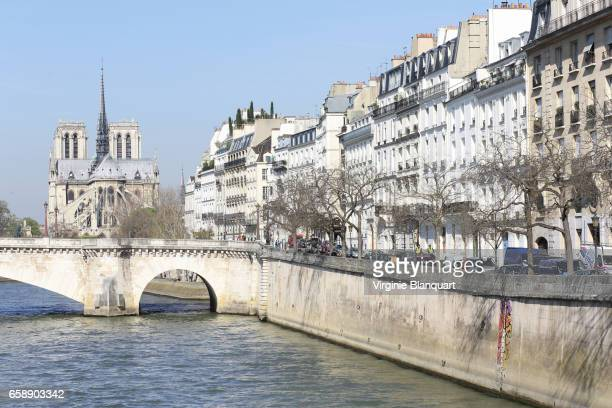 Paris, France, Notre-Dame and the Seine river on a sunny day. 27 March 2017