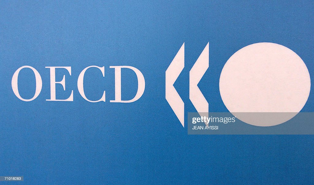 OECD logo taken 23 May 2006 in Paris during a press conference AFP PHOTO JEAN AYISSI