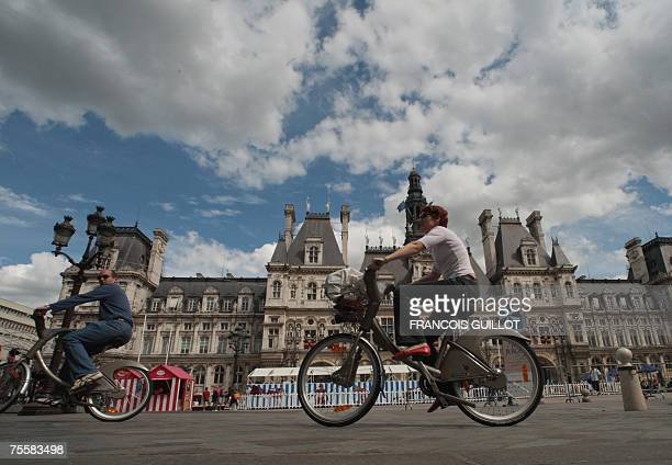 People ride 'Velib' bicycles 21 July 2007 in Paris a few days after the launch of the first selfservice bicycles The French capital is bracing for a...