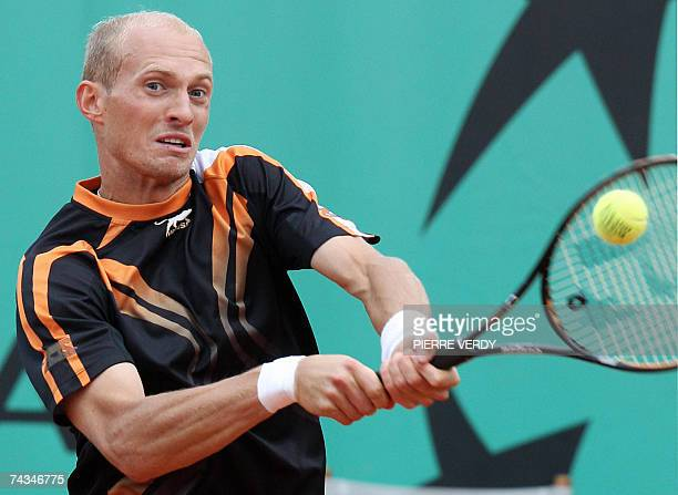 Russian player Nikolay Davydenko hits a backhand shot to Italian player Stefano Galvani during their French Tennis Open first round match at Roland...