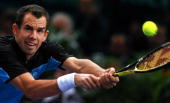 Slovakia's Dominik Hrbaty stretches to return to Russia's Nikolay Davydenko during their Paris Tennis Masters Series final match at Bercy indoor...