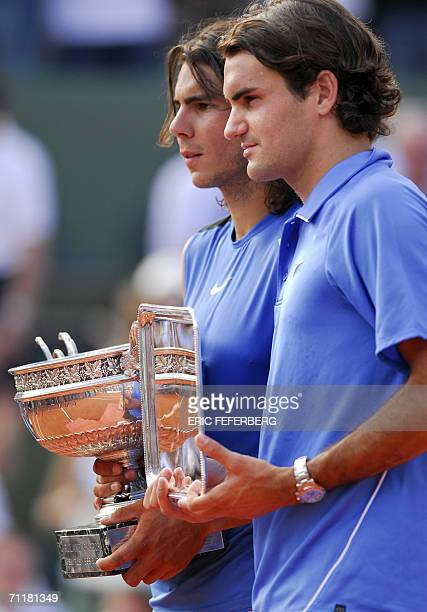 Spain's Rafael Nada and Swiss Roger Federer pose with their trophies after the French tennis Open final against at Roland Garros in Paris 11 June...
