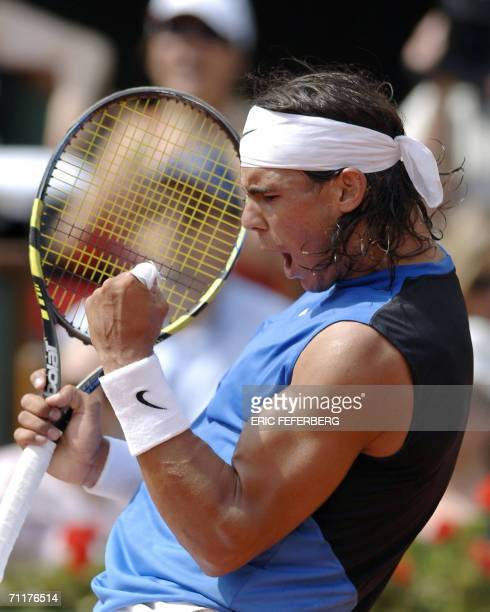 Spain's Rafael Nadal jubilates after winning a point against Swiss Roger Federer during the French tennis Open final at Roland Garros in Paris 11...
