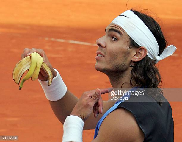Spain's Rafael Nadal shows his throat after eating a banana during his match against France's PaulHenri Mathieu on the center court of the French...