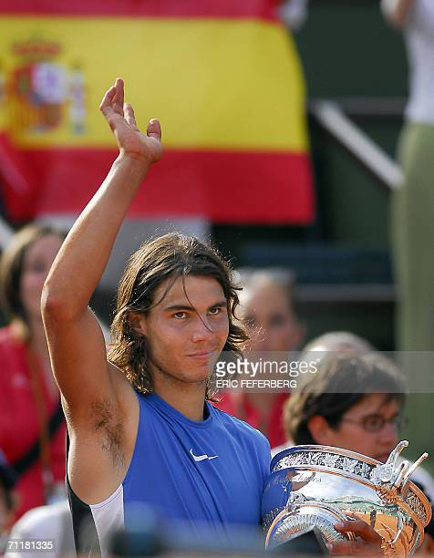 Spain's Rafael Nadal waves the crowd after winning the French tennis Open final against Swiss Roger Federer at Roland Garros in Paris 11 June 2006...