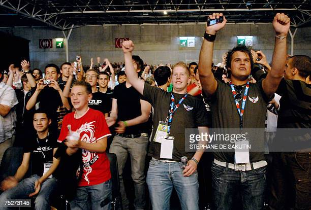 The audience supports competitors playing video games during the final of the 5th edition of the Electronic Sports World Cup ESWC 2007 event 08 July...