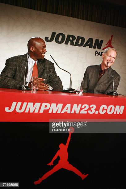 US former Basketball superstar Michael Jordan gives a press conference next to the Nike vicepresident Tinker Hatfield 17 October 2006 in Paris on the...