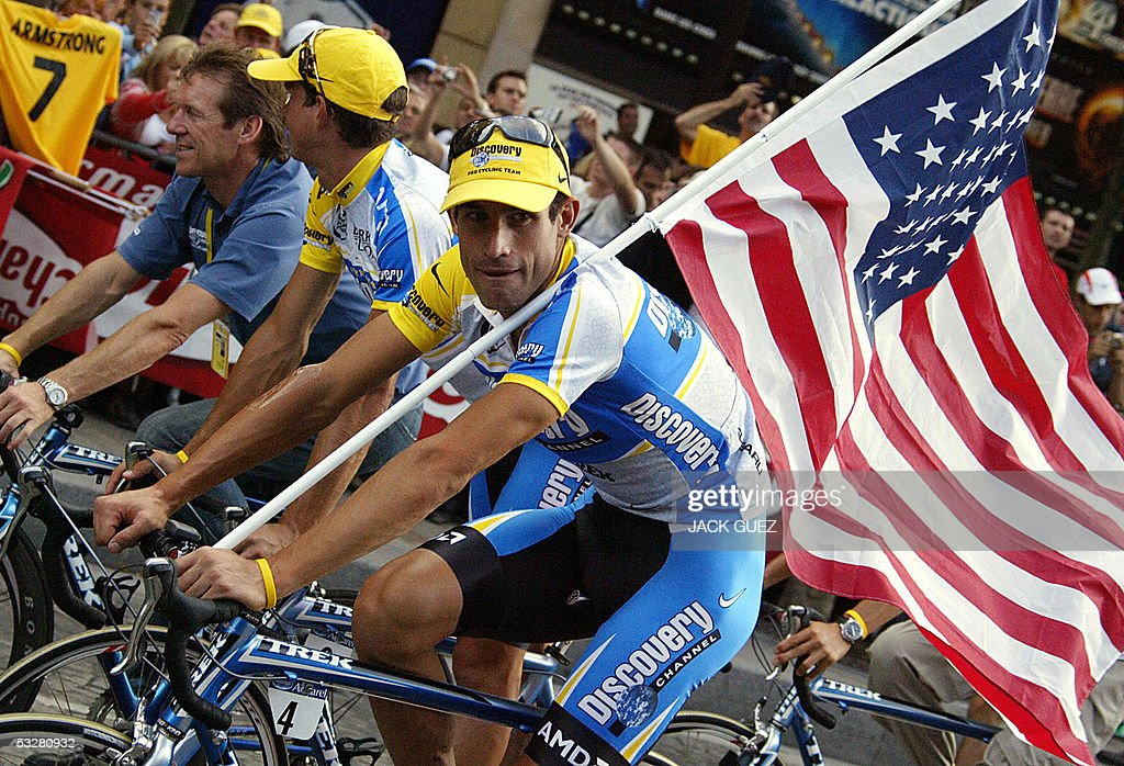 US George Hincapie rides with Discovery Channel teammates during the honour lap after the final stage of the 92nd Tour de France cycling race on the Champs Elysees in Paris, 24 July 2005. American Lance Armstrong waved goodbye to what has been a remarkable cycling career after securing his seventh consecutive yellow jersey following the 21st and final stage of the Tour de France here Sunday. The 33-year-old Discovery Channel team leader, who announced his retirement a few months ago, finished the race with a 4min 40sec lead on Italian Ivan Basso with Germany's Jan Ullrich, the 1997 winner, finishing third on the podium at 6:21 behind Armstrong.