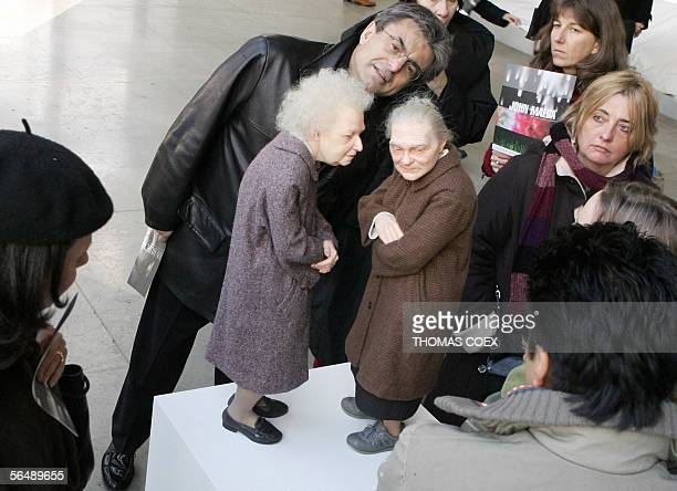Visitors look at 'Two Women' by Australianborn sculptor Ron Mueck during an exhibition at the Cartier Foundation for Contemporary Art in Paris 27...