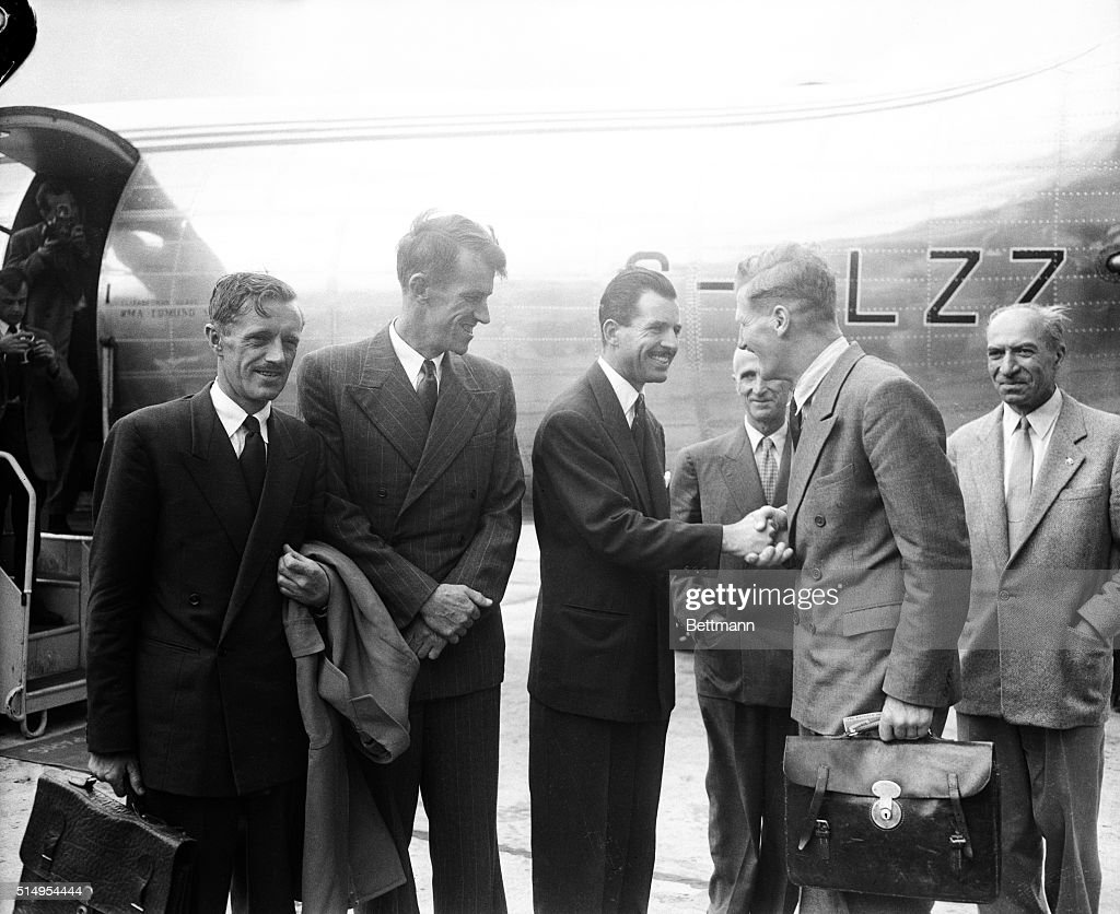 French climber, <a gi-track='captionPersonalityLinkClicked' href=/galleries/search?phrase=Maurice+Herzog&family=editorial&specificpeople=1140703 ng-click='$event.stopPropagation()'>Maurice Herzog</a>, welcomes members of British Expedition who climbed Mt. Everest (Himalayas) - including Sir <a gi-track='captionPersonalityLinkClicked' href=/galleries/search?phrase=Edmund+Hillary&family=editorial&specificpeople=121538 ng-click='$event.stopPropagation()'>Edmund Hillary</a>.