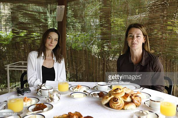 French First lady Carla Sarkozy Melinda Gates spouse of US IT mogul Bill Gates and AIDS World Fund Director Michel Kazatchkine on January 27 2010 in...