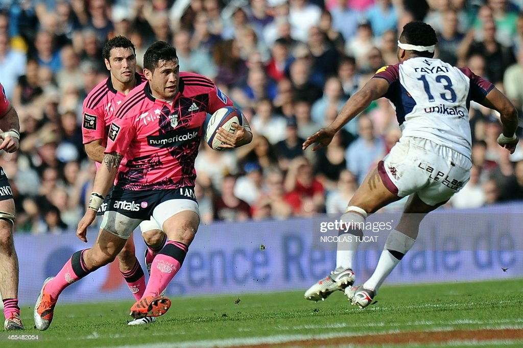 Paris' French flanker <a gi-track='captionPersonalityLinkClicked' href=/galleries/search?phrase=Raphael+Lakafia&family=editorial&specificpeople=7183172 ng-click='$event.stopPropagation()'>Raphael Lakafia</a> (L) runs with the ball during the French Top 14 rugby union match between Bordeaux-Begles (UBB) and Stade français on March 7, 2015 at the Chaban-Delmas stadium in Bordeaux, southwestern France. AFP PHOTO / NICOLAS TUCAT