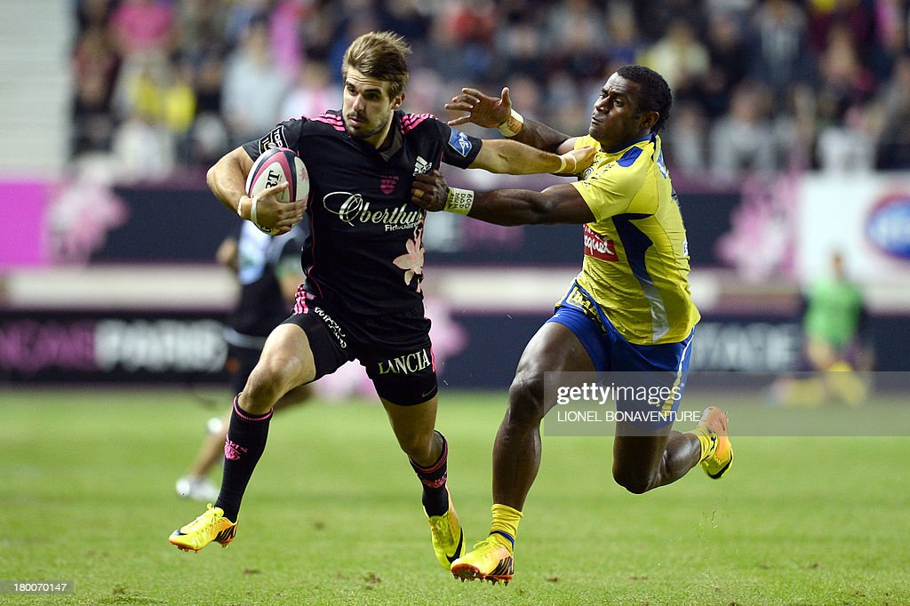 Paris' French fullback Hugo Bonneval (L) vies with Clermont's Fijian winger Sitiveni Sivivatu during the French Top 14 rugby Union match Stade Francais vs Clermont on September 8, 2013 at the Jean Bouin stadium in Paris.