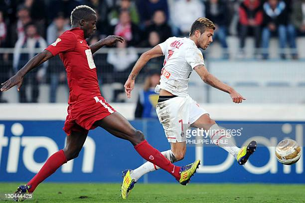 Paris' French midfielder Jeremy Menez vies with Dijon's French defender Zakaria Diallo during the French League Cup match Dijon vs Paris on October...