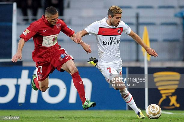Paris' French midfielder Jeremy Menez vies with Dijon's French defender Cedric Varrault during the French League Cup match Dijon vs Paris on October...