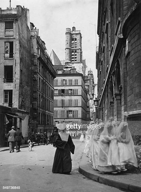 Paris girls after the First Communion in the background church St Gervair