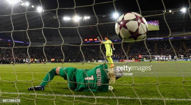 Paris goalkeeper Katarzyna Kiedrzynek reacts after Lyon goalkeeper Sarah Bouhaddi had scored the winning penalty during the UEFA Women's Champions...