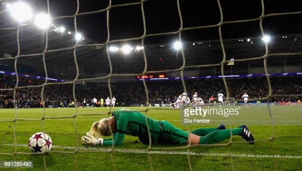 Paris goalkeeper Katarzyna Kiedrzynek reacts after Sarah Bouhaddi had scored the winning penalty during the UEFA Women's Champions League Final...