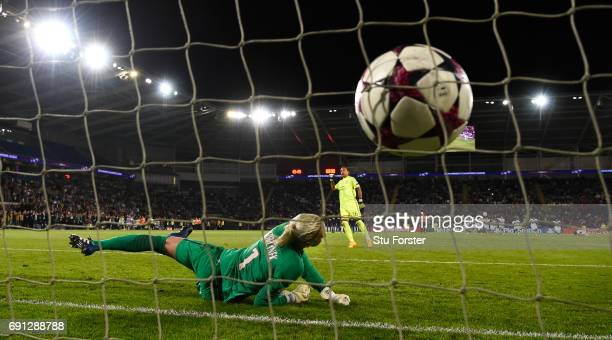 Paris goalkeeper Katarzyna Kiedrzynek reacts as Lyon goalkeeper Sarah Bouhaddi scores the winning penalty during the UEFA Women's Champions League...