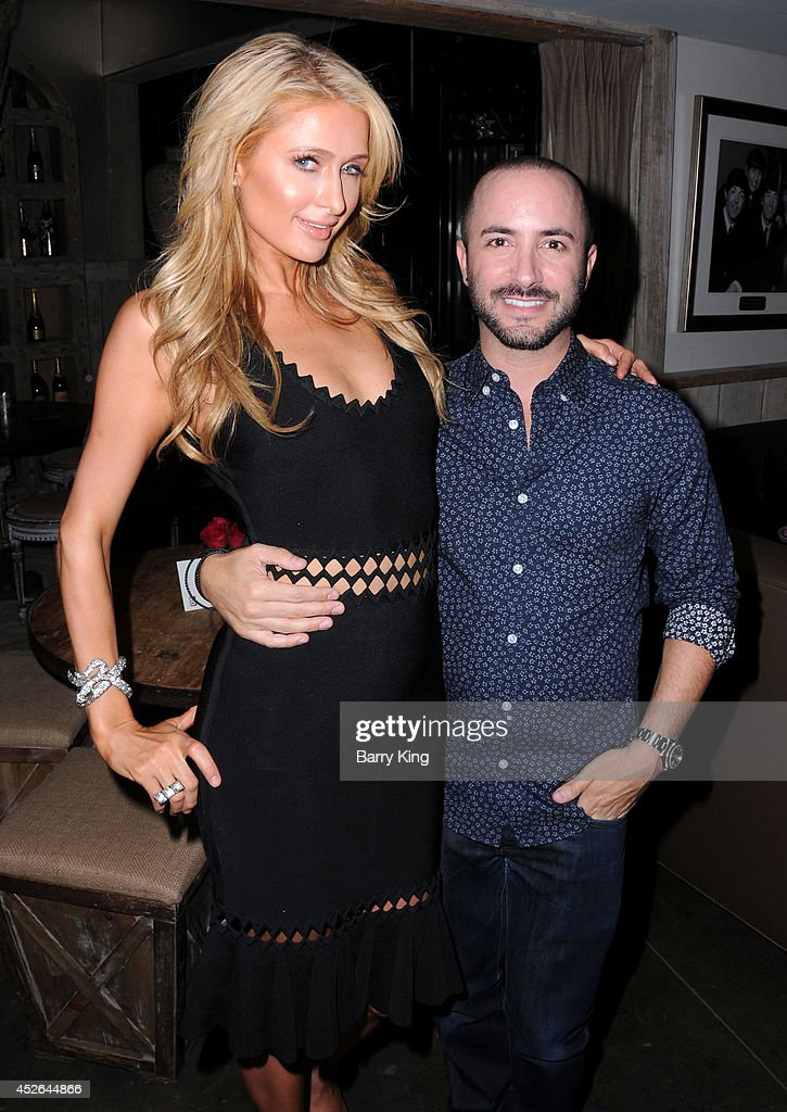 <a gi-track='captionPersonalityLinkClicked' href=/galleries/search?phrase=Paris+Hilton&family=editorial&specificpeople=171761 ng-click='$event.stopPropagation()'>Paris Hilton</a> (L) and agent David Todd attend the DT Model Management 2 Year Anniversary Celebration on July 24, 2014 at Pump in West Hollywood, California.
