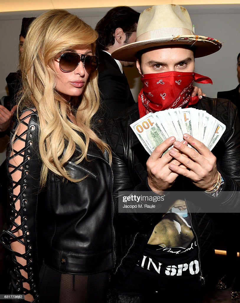 Paris Hilton and Alec Monopoly attend Philipp Plein Boutique Opening during Milan Men's Fashion Week Fall/Winter 2017/18 on January 15, 2017 in Milan, Italy.