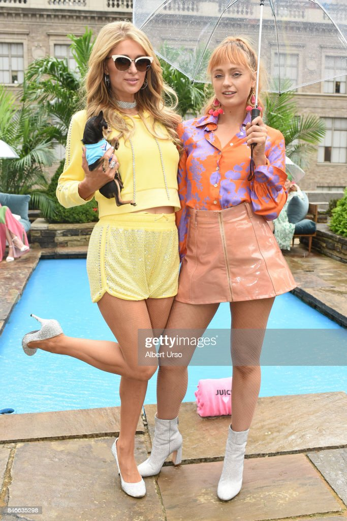 Paris Hilton and Brandi Howe (L-R) pose at the Juicy Couture presentation during New York Fashion Week at 620 Loft & Garden on September 13, 2017 in New York City.