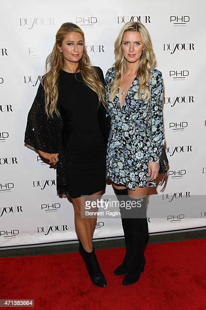 Paris Hilton and businesswoman Nicky Hilton attend Jason Binn's celebration of Paris Hilton's Spring Cover on DuJour Magazine on April 27 2015 in New...
