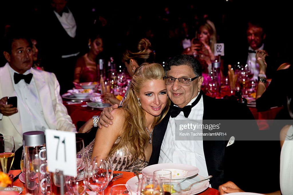 <a gi-track='captionPersonalityLinkClicked' href=/galleries/search?phrase=Paris+Hilton&family=editorial&specificpeople=171761 ng-click='$event.stopPropagation()'>Paris Hilton</a> and Cyrus Poonawalla attend amfAR's 21st Cinema Against AIDS Gala presented by WORLDVIEW, BOLD FILMS, and BVLGARI at Hotel du Cap-Eden-Roc on May 22, 2014 in Cap d'Antibes, France.