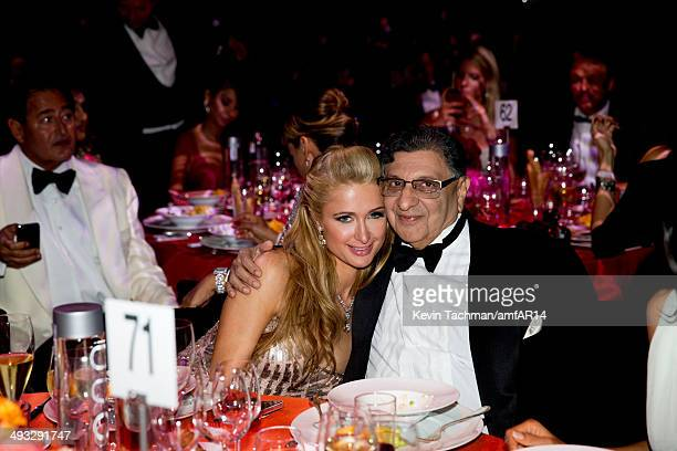 Paris Hilton and Cyrus Poonawalla attend amfAR's 21st Cinema Against AIDS Gala presented by WORLDVIEW BOLD FILMS and BVLGARI at Hotel du CapEdenRoc...
