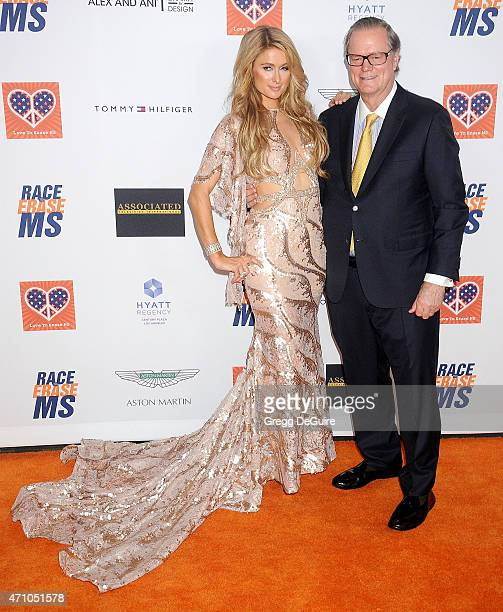 Paris Hilton and dad Rick Hilton arrive at the 22nd Annual Race To Erase MS at the Hyatt Regency Century Plaza on April 24 2015 in Century City...
