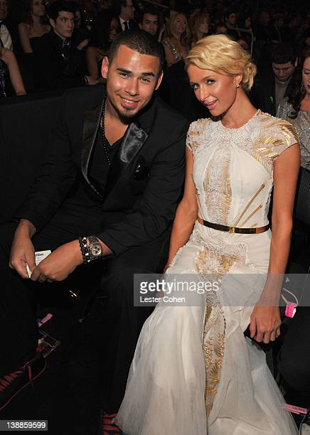 Paris Hilton and DJ Afrojack attend The 54th Annual GRAMMY Awards at Staples Center on February 12 2012 in Los Angeles California