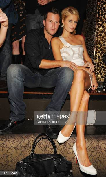 Paris Hilton and Doug Reinhardt attend Tao Nightclub at TAO Nightclub at the Venetian on February 20 2010 in Las Vegas Nevada