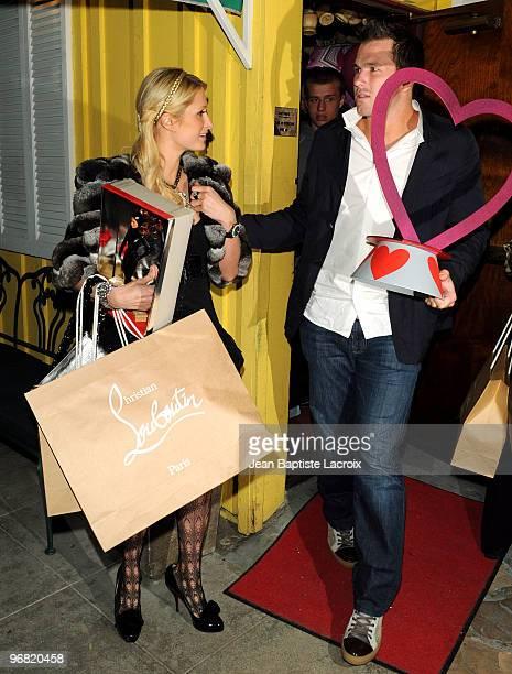 Paris Hilton and Doug Reinhardt celebrate Paris Hilton's birthday at Dan Tana's on February 17 2010 in Los Angeles California