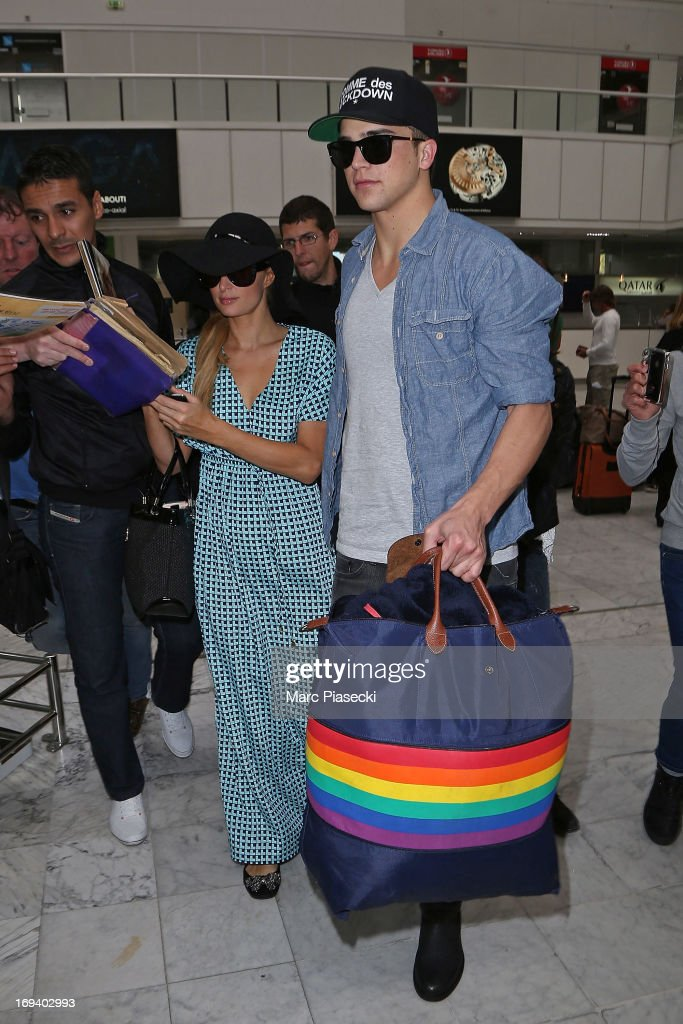<a gi-track='captionPersonalityLinkClicked' href=/galleries/search?phrase=Paris+Hilton&family=editorial&specificpeople=171761 ng-click='$event.stopPropagation()'>Paris Hilton</a> and her boyfriend River Viperii are seen at Nice airport during the 66th Annual Cannes Film Festival on May 24, 2013 in Nice, France.