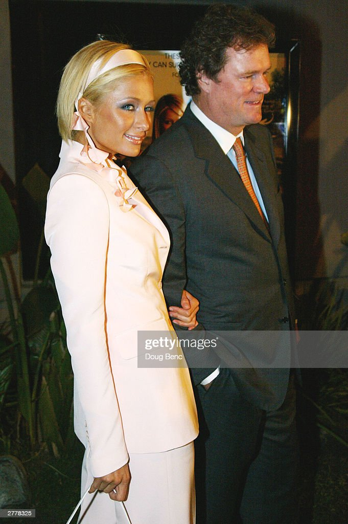 <a gi-track='captionPersonalityLinkClicked' href=/galleries/search?phrase=Paris+Hilton&family=editorial&specificpeople=171761 ng-click='$event.stopPropagation()'>Paris Hilton</a> (L) and her father Rick Hilton arrive for the premiere party for 'The Simple Life' on December 2, 2003 at Bliss in Los Angeles, California.