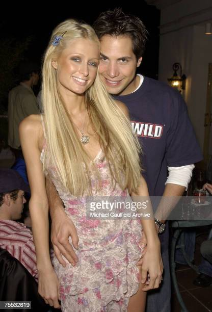 Paris Hilton and Joe Francis CEO of Girls Gone Wild during Girls Gone Wild's Annual Mardi Gras Party at the Embers Steak House in New Orleans LA