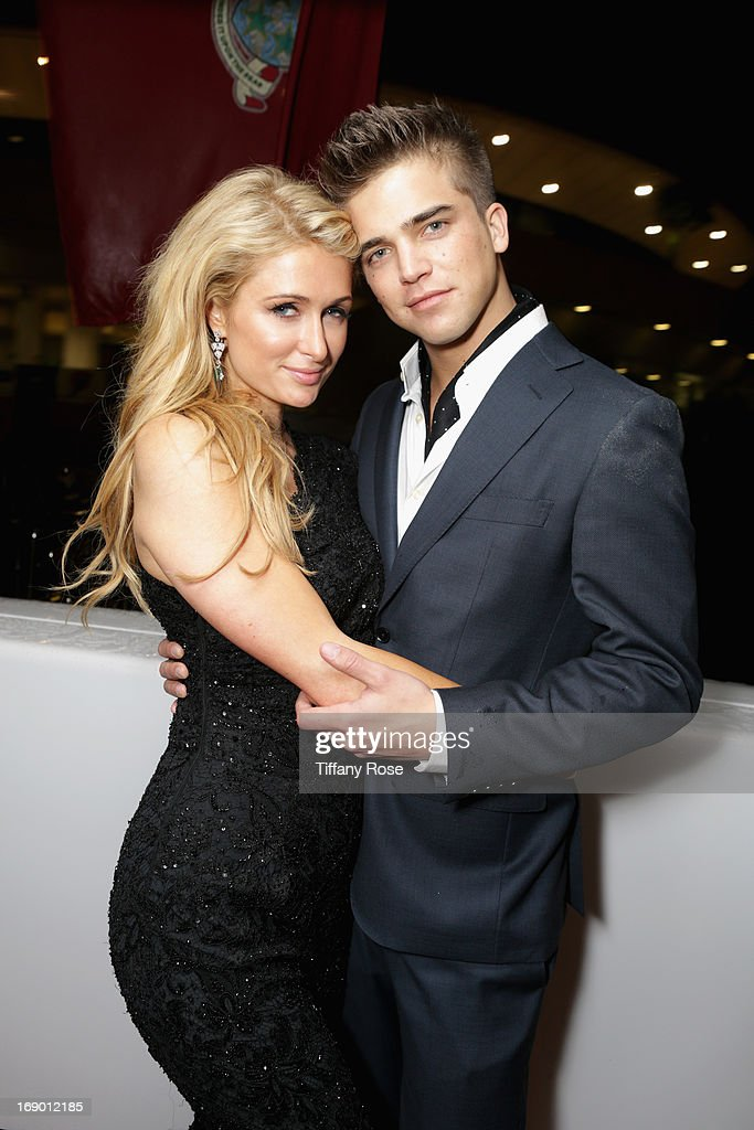 <a gi-track='captionPersonalityLinkClicked' href=/galleries/search?phrase=Paris+Hilton&family=editorial&specificpeople=171761 ng-click='$event.stopPropagation()'>Paris Hilton</a> and model <a gi-track='captionPersonalityLinkClicked' href=/galleries/search?phrase=River+Viiperi&family=editorial&specificpeople=8600726 ng-click='$event.stopPropagation()'>River Viiperi</a> attend the Zero Theorem Party Hosted by Terry Gilliam The 66th Annual Cannes Film Festival at Torch at Vegaluna Beach Club on May 18, 2013 in Cannes, France.